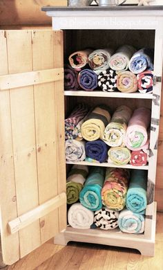 Restore an old cabinet into a comfy space for your pool and beach towels. Keep the cabinet near your outdoor patio to dry off before you enter back into the house.