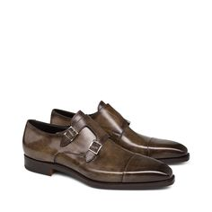 Toe-cap monkstraps in dark-brown leather with double side-buckles, and leather soles with an excellent Goodyear welt-construction. Their natural refinement is a guarantee of elegance.