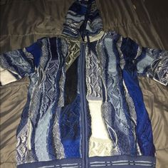 Authentic men's Coogi sweater. Authentic men's Coogi sweater. Size medium new with tags. Front zipper and hoodie! Blue. Purchased from Pure Atlanta COOGI Sweaters Cardigans