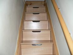 *These are the stairs into the basement. We have managed to get loads of stuff in them, each drawer goes back for almost a metre. You don't notice them on the way down but they are revealed in all their practical glory on the way up.*