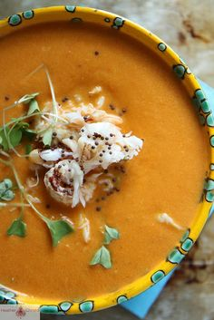 Spicy Tomato Crab Soup  1 yellow onion, diced 3 cloves garlic, chopped 2 red peppers, chopped, seeds and veins removed 8 cups tomatoes 1-2 jalapeno peppers sliced, stemmed but leave the seeds and veins 4 cups water ½ cup cream kosher salt ½ lbs fresh picked crab mustard seeds for garnish (optional)