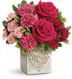 Celebrate someone special with this sweet bouquet of red and pink roses, arranged in a modern ombre style. Hand-delivered in a charming stoneware cube vase with artisanal reactive glaze and intricate heart motif, it's a gift that will brighten anyone's Valentine's Day!