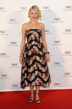 Naomi Watts in a black and bold floral ankle length cocktail dress, keeping accessories and make-up simple.
