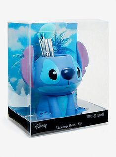 But that's not all — it comes with a brush holder shaped like Stitch himself. - Disney Lilo & Stitch Makeup Brush SetDisney Lilo & Stitch Makeup Brush Set, Best Picture For Skinc - Stitch Disney, Lilo Et Stitch, Makeup Brush Holders, Makeup Brush Set, Stitches Makeup, Cute Stitch, Stitch Toy, Stitch And Angel, Disney Makeup