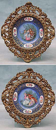 Pair of giltwood framed porcelain plates