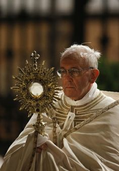 Pope Francis carries a monstrance holding the Blessed Sacrament during the Corpus Christi observance May 30 in Rome. (CNS photo/Paul Haring)