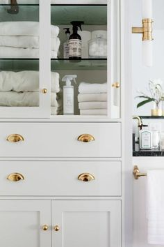 Glass Front Bathroom Linen Cabinet with Polished Brass Hardware - Contemporary - Bathroom Bathroom Interior, Modern Bathroom, Small Bathroom, Master Bathroom, Bathroom Closet, Bathroom Ideas, Parisian Bathroom, Bathroom Tower, Bathroom Renovations