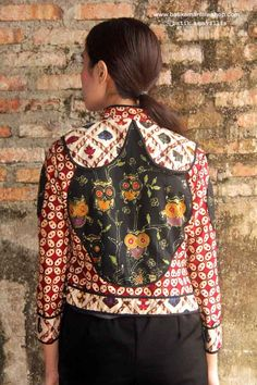 Batik Amarillis's Torera Vol 2 no 1 combining the patterns,colours,brilliance,elegance & luxurious materials intricate to this opulent piece with the androgynous classic . Batik Fashion, Women's Fashion, Cropped Jackets, Amarillis, Androgynous, Feminine Style, Vera Bradley Backpack, Ethnic, Colours