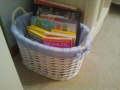 So many books, so few shelves...thank goodness for cute baskets from Pottery Barn!