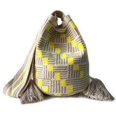 $114.00 USD Traditional single-thread large mochila bags are one of the most iconic crafts in Colombia. Each piece has taken over 20 days to make and is sure to last you throughout the years. Make it your go to bag for this summer. It's hard to have just one!    https://www.lombiaandco.com/product-category/single-thread-wayuu-bags/large-single-thread-wayuu-bags/