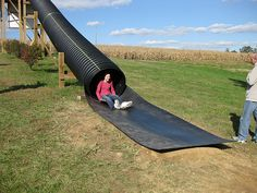 """Grace shooting out of the """"Pipe Slide"""" at the Owen Farm Fall Festival 