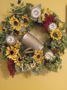 Grapevine kitchen wreath with sunflowers and jello molds