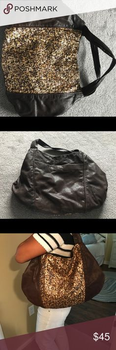 Hobo purse Brand new spacious gorgeous leather/sequins purse.  Purchased and never ever used.  Clearing my closet and downsizing. Banana Republic Bags Hobos