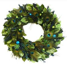 Who needs a traditional wreath when you can have one with peacock feathers.