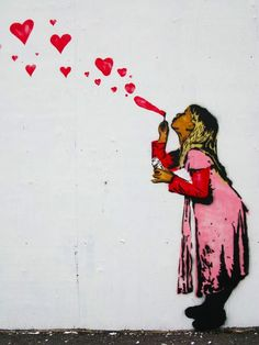 graffiti -- girl blowing heart-bubbles up to the sky