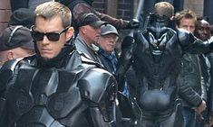 RoboCop star Joel Kinnaman reveals his bionic behind. and he even has an assistant on hand to keep it shiny Joel Kinnaman, Black Art Pictures, Black Ops, Behind, On Set, That Look, Batman, Superhero, Stars