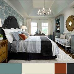 This master bedroom is designed around a mix of restful blues, neutral creams, then we added a shot of black and cognac for a modern edge.