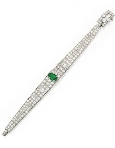 Platinum, Emerald and Diamond Bracelet, Cartier The tapered strap centered by a pear-shaped emerald weighing approximately 1.90 carats, accented by two old European-cut diamonds weighing approximately 1.50 carats, further set with numerous smaller old European and single-cut diamonds weighing approximately 9.00 carats, length 6½ inches, signed Cartier, numbered 2615042; circa 1925. With fitted and signed box.