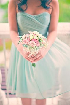 Love the color of this bridesmaid's dress and bouquet