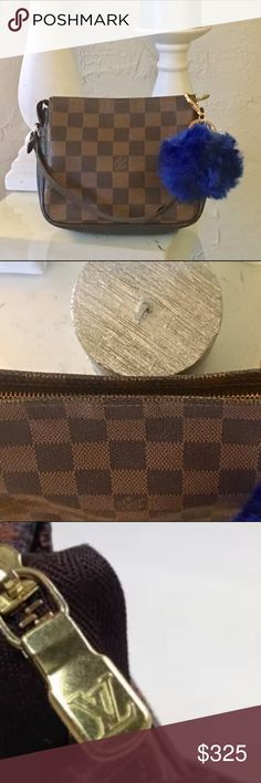 % Authentic Louis Vuitton Damier truth pouch. Authentic Louis Vuitton Damier pouch. Like new condition! Good to carry make up, money, wallet and essentials.      Size in inches (approx.)W 6.7x H 5.5 x D 1.9      Strap Drop  3.9 Comes with pompom key chain Louis Vuitton Bags Clutches & Wristlets