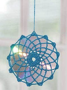 Sun Sparkler Crochet Pattern Download from e-PatternsCentral.com -- Turn shiny CDs into festive light reflectors by covering them in sparkling metallic crochet!