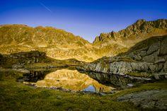 Shadowing the valley... | Small lake in Podragu glacier valley - Fagaras massif, Romania