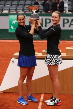 ♔ ♔Kristina Mladenovic and Caroline Garcia of France lift the trophy following their victory during the Ladies Doubles final match against Elena Vesnina and Ekaterina Makarova of Russia on day fifteen of the 2016 French Open at Roland Garros on June 5, 2016 in Paris, France. - 2016 French Open - Day Fifteen