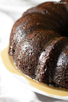 This Kahlúa Coffee Poke Cake is super moist cake infused with a luscious coffee and chocolate liqueur mixture. It's a chocolate and coffee lovers dream!