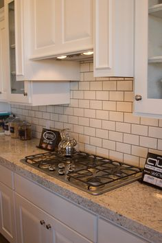 Thornapple kitchen before and after Romano Blanco granite white