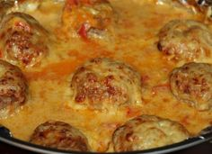 Фото к рецепту: Тефтели запеченные в духовке в сметанном соусе