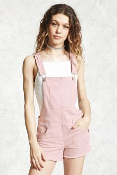 A pair of distressed denim overall shorts featuring adjustable straps, a bib patch pocket, five-pocket construction, a triple button side closure, and a frayed hem. Girls Summer Outfits, Teen Fashion Outfits, Edgy Outfits, Short Outfits, Denim Fashion, Fashion Dresses, Cute Outfits, Overalls Outfit, Bib Overalls