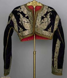 Albania & Montenegro, Women's Folk Garments : 1 green wool jacket w/ metallic embroidery ; 1 purple velvet vest w/ metallic silver embroidery ; 1 cropped purple velvet jacket covered in silver & gold metallic soutache, 19th c