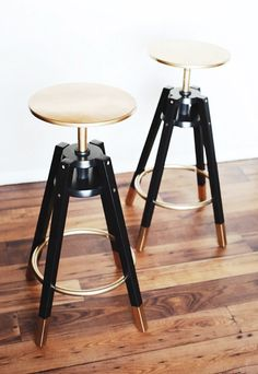 Gilded Barstools-Oh, the magic of gold spray paint. These $40 stools get a glam update thanks to a gilded once-over.