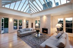 This large modern conservatory is very nice love the feature wall with the fire looks very cosy. Spacious room with just the seating area and coffee table. Open Plan Kitchen Living Room, Spacious Living Room, Open Plan Living, Living Spaces, Conservatory Interiors, Modern Conservatory, Cosy Conservatory Ideas, Conservatory Extension, House Extension Design