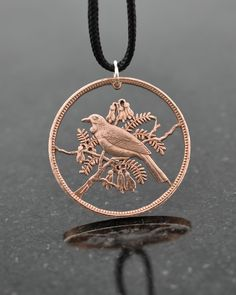 Meticulously hand-drilled and hand-cut from an actual New Zealand One Penny Coin. Diameter Comes on an elegant black cord. Please contact us with any questions. Penny Jewelry, Coin Jewelry, Coin Crafts, Art Crafts, Tui Bird, Coin Art, Penny Coin, Jewellery Boxes, Coin Pendant
