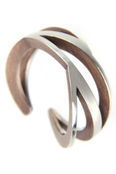 """By HUGO YEUNG-HONG-KONG -CN """"Hugo Yeung – his sculptural silver bangles and rings feature overlapping or intertwined squares and circles for a cool look"""" VIA http://www.the-dvine.com/2012/07/local-stars-jewellers-you-want-to-know/"""