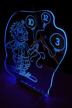 Clock with blue backlight LED in the shape of a clown. New design.