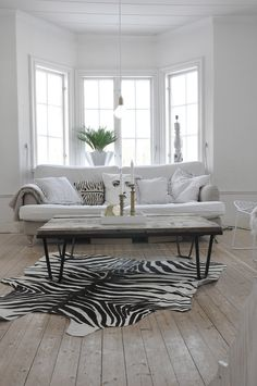 Faux Zebra Rug, table & how white works in the space. In a hot climate, white is cooling.