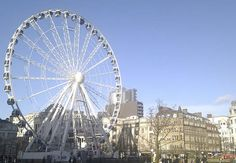Get spectacular views of the city on the Wheel of Manchester in Piccadilly Gardens