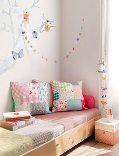 I like the tree mural done with magnetic paint - what a great way to change things out in a kid's room without putting holes everywhere.