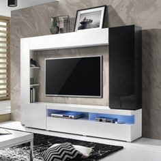 The Helvetia Merida TV Wall Unit - White is going to let your TV earn its place at the center of your living room. This all-purpose unit frames your. Floating Tv Stand, Tv Entertainment Centers, Rack Tv, Living Room Tv Unit, Tv Unit Design, Flat Panel Tv, Media Wall, Ceiling Decor, Engineered Wood