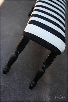 black and white bench. 72″ MDF,  4 pine legs, 15″ tall, spray paint, Foam padding, Quilt batting, Fabric, Dowel Screws