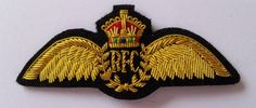 WWI Royal Flying Corps aircrew insignia. These were the first pilot wings in the world and issued in February 1913. They were replaced by the RAF wings in 1918. Embroidered in gold wire bullion on a black wool felt background.