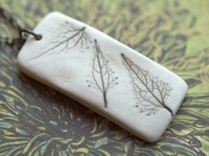 Earthy Porcelain Pendant with Impression of a leaves.. $32.00, via Etsy.