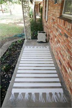 How to Paint Concrete—a Patio Makeover I had NO IDEA you could paint concrete! This concrete painted rug is so cute and exactly what i need to make our boring patio a bit more inviting and fun. I can definitely spend an hour or two to do this. Patio Diy, Patio Rugs, Outdoor Rugs, Patio Ideas, Outdoor Living, Porch Rugs, Deck Rug, Backyard Ideas, Outdoor Spaces