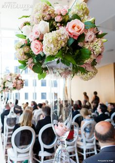 WedLuxe: #Toronto #wedding held at the Shangri-La Hotel featuring beautiful floral arrangements