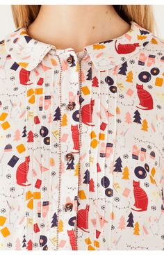 Gorgeous printed blouse with cats and trees and lots of other pretty things. I'm in love.