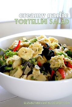 I love the idea of using the cheese tortellini! // Salad: 1 large package of fresh cheese tortellini 1 head broccoli, cut into small pieces 2 cans of olives, sliced 1 red bell pepper, julienned 2 jars marinated artichoke hearts, diced Dressing: 1 cup canola oil 1/4 cup red wine vinegar 1/4 cup sour cream 2 cloves garlic, minced 2 Tablespoons sugar 1 1/2 teaspoons kosher salt 1 1/2 teaspoons black pepper 1/2 teaspoon dry mustard 2 teaspoons dried parsley