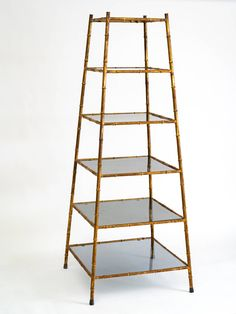 Gilt Obelisk Form Etagere | From a unique collection of antique and modern bookcases at https://www.1stdibs.com/furniture/storage-case-pieces/bookcases/