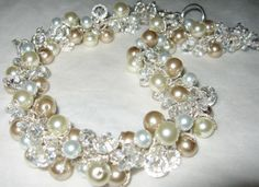 Floating white, ivory, champagne pearl and crystal hand knit spiral cluster twist.....wonder if I could figure this out on my own???